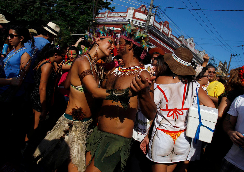 ". Revelers dance during an annual block party known as ""Ceu na Terra\"" (or Sky on Earth), one of the many carnival parties to take place in the neighborhoods of Rio de Janeiro February 2, 2013. REUTERS/Pilar Olivares"