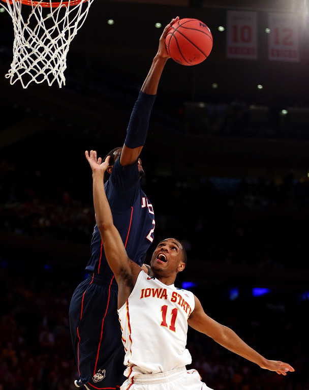 . DeAndre Daniels #2 of the Connecticut Huskies blocks the shot of Monte Morris #11 of the Iowa State Cyclones during the regional semifinal of the 2014 NCAA Men\'s Basketball Tournament at Madison Square Garden on March 28, 2014 in New York City.  (Photo by Elsa/Getty Images)