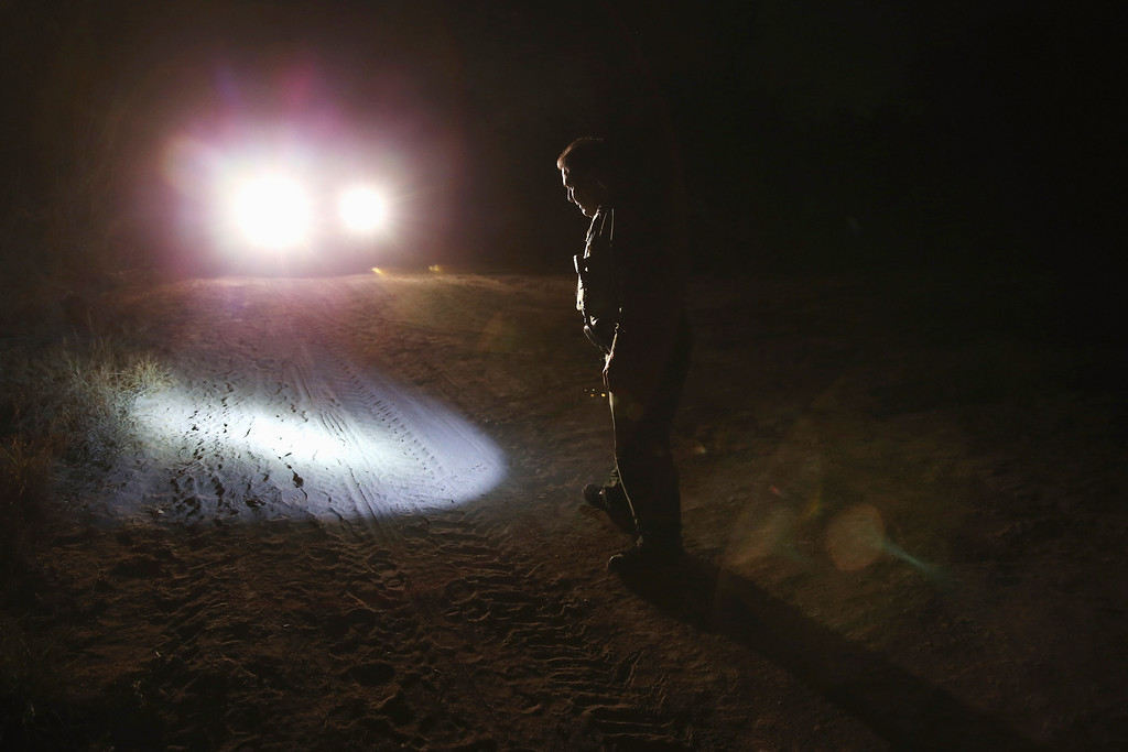 . MCALLEN, TX - APRIL 10:  U.S. Border Patrol agent Sal De Leon looks for tracks of undocumented immigrants while on patrol near the U.S.-Mexico border on April 10, 2013 in McAllen, Texas. According to the Border Patrol, undocumented immigrant crossings have increased more than 50 percent in Texas\' Rio Grande Valley sector in the last year. Border Patrol agents say they have also seen an additional surge in immigrant traffic since immigration reform negotiations began this year in Washington D.C. Proposed refoms could provide a path to citizenship for many of the estimated 11 million undocumented workers living in the United States.  (Photo by John Moore/Getty Images)