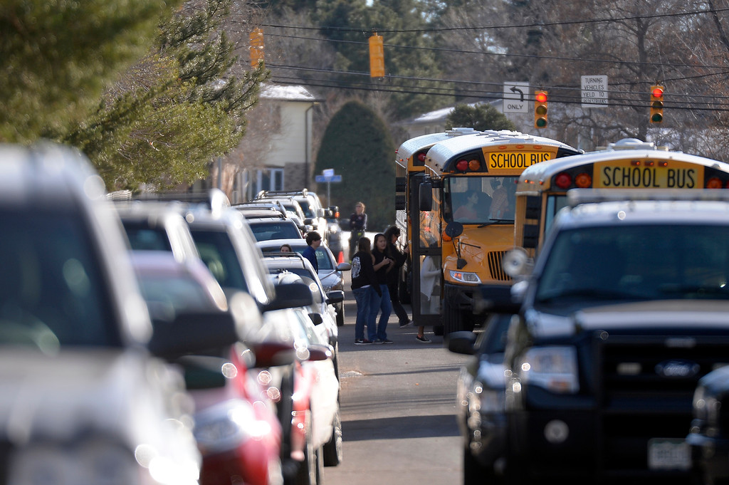 . CENTENNIAL, CO - Students load up on a bus as they were taken to Euclid Middle School in Littleton. A gunman made his way to Arapahoe High School looking for a teacher December 13, 2013. The gunman was targeting a teacher at the school. The gunman shot two students in the process and then turned the gun on himself. DECEMBER 13:  (John Leyba, The Denver Post)