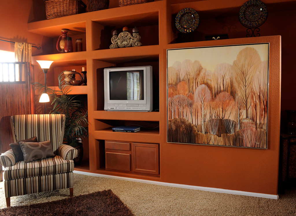 . The large painting on the right side of the bookcase softens the deep colors in the master bedroom. (Photo By Cyrus McCrimmon/The Denver Post)