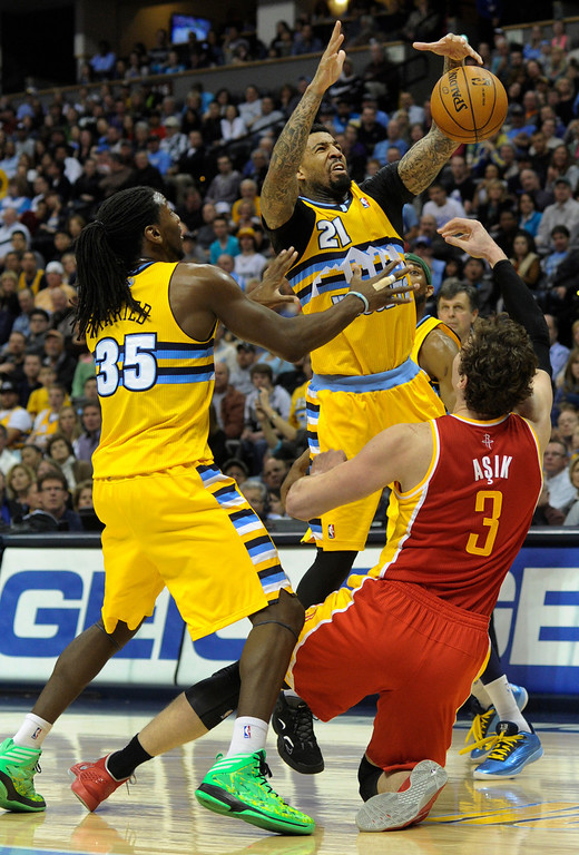. DENVER, CO. - APRIL 6: Wilson Chandler (21) of the Denver Nuggets stole the ball from Omer Asik (3) of the Houston Rockets in the first half. The Denver Nuggets hosted the Houston Rockets at the Pepsi Center Saturday night, April 6, 2013. Photo By Karl Gehring/The Denver Post)