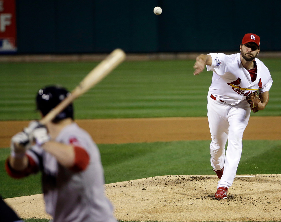 . St. Louis Cardinals starting pitcher Adam Wainwright throws during the first inning of Game 5 of baseball\'s World Series against the Boston Red Sox Monday, Oct. 28, 2013, in St. Louis. (AP Photo/David J. Phillip)