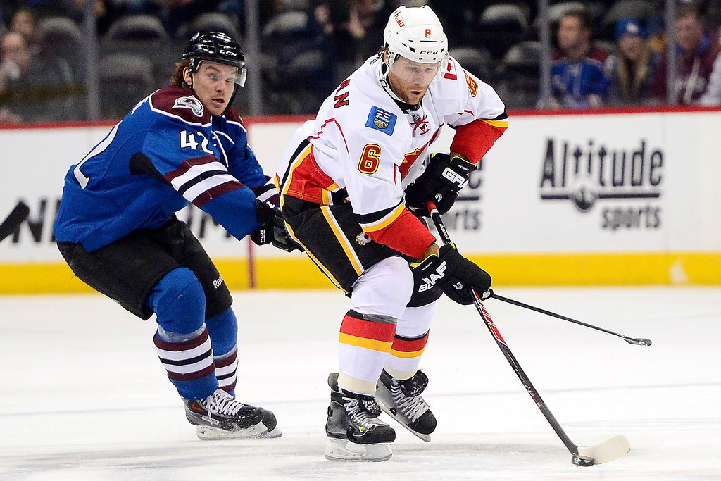 . Brad Malone (42) of the Colorado Avalanche defends Dennis Wideman (6) of the Calgary Flames during the first period.  (Photo by AAron Ontiveroz/The Denver Post)