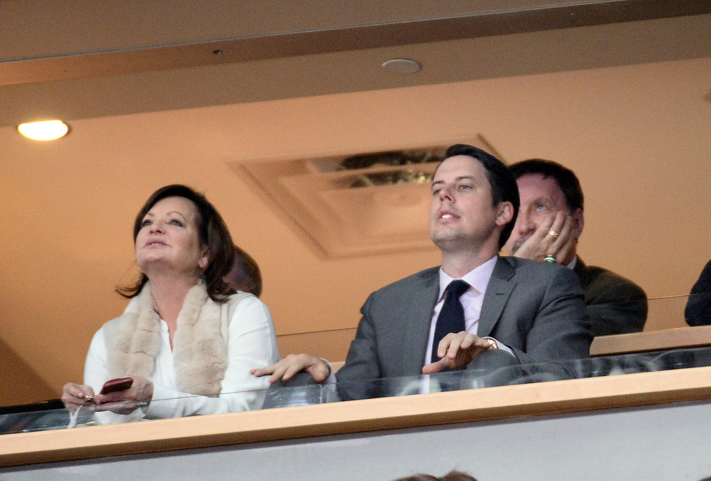 . Denver Nuggets President Josh Kroenke in front sit with his dad Stan Kroenke in their box during the game against the  Oklahoma City Thunder December 17, 2013 at Pepsi Center. (Photo by John Leyba/The Denver Post)