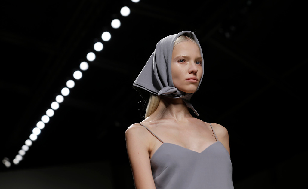 . A model wears a creation for Max Mara women\'s Spring-Summer 2014 collection, part of the Milan Fashion Week, unveiled in Milan, Italy, Thursday, Sept. 19, 2013. (AP Photo/Luca Bruno)