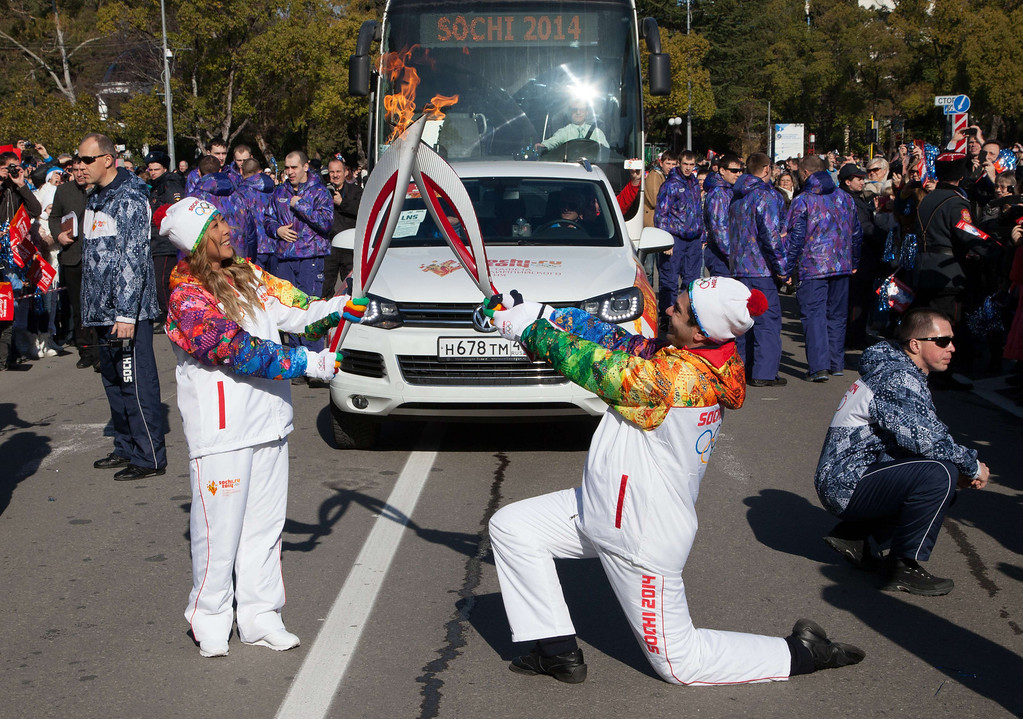 . A handout picture taken during the Sochi 2014 Winter Olympic torch relay on February 7, 2014, and released by the Sochi 2014 Winter Olympics Organizing Committee shows Bolshoi ballet star Nikolai Tsiskaridze (R) and Russian pop singer Anita Tsoy \'kissing\' with their torches to pass the Olympic in central district of the Black Sea resort of Sochi. Russian torchbearers has started in October 2013 the history\'s longest Olympic torch relay ahead of Winter Games in Sochi, which will take the flame across the country through all 83 of its regions, including extreme locales such as Chukotka, the remote region in Russia\'s Far East, the turbulent North Caucasus, and even Russia\'s European exclave Kaliningrad. AFP PHOTO / SOCHI 2014 ORGANIZING COMMITTEE-/AFP/Getty Images