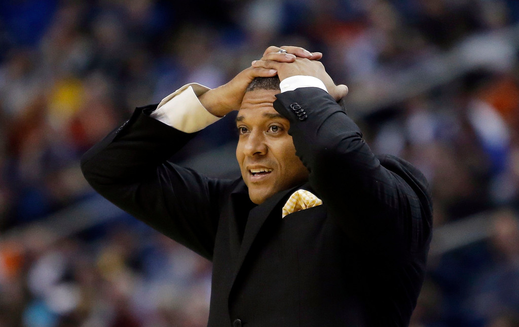 . Milwaukee head coach Rob Jeter reacts to a call during first half of a second-round game against Villanova in the NCAA college basketball tournament in Buffalo, N.Y., Thursday, March 20, 2014. (AP Photo/Nick LoVerde)