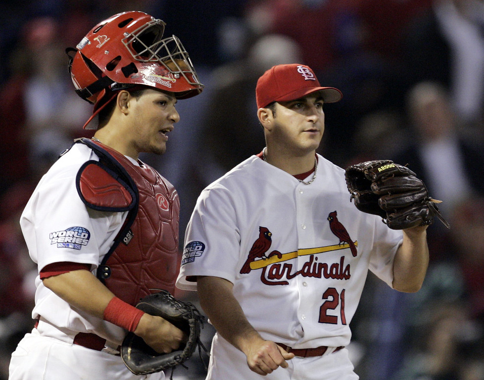 . St. Louis Cardinals catcher Yadier Molina, left, talks with pitcher Jason Marquis during a rough third inning against the Boston Red Sox in Game 4 of the World Series Wednesday, Oct. 27, 2004, in St. Louis. (AP Photo/Al Behrman)