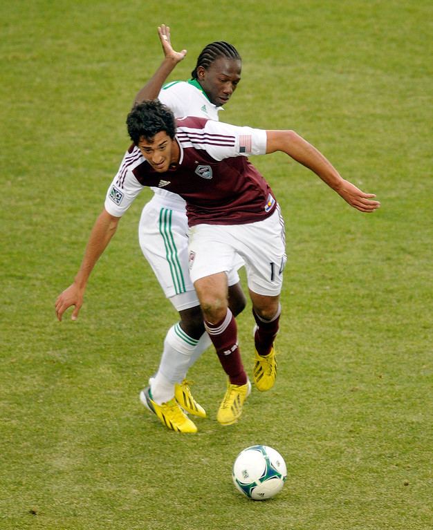 . Rapids\' forward Tony Cascio (14) worked his way past Jose Adolfo Valencia (20) of the Portland Timbers in the second half. The Colorado Rapids tied the Portland Timbers 2-2 Saturday, March 30, 2013 at Dick\'s Sporting Goods Park in Commerce City.  Photo By Karl Gehring/The Denver Post)