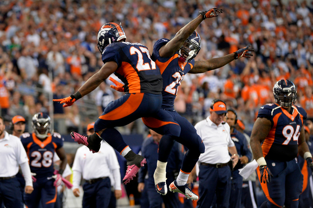 . Knowshon Moreno, left, now with the Dolphins, celebrates with Ronnie Hillman after scoring a touchdown against the Chargers. (Joe Amon/The Denver Post)