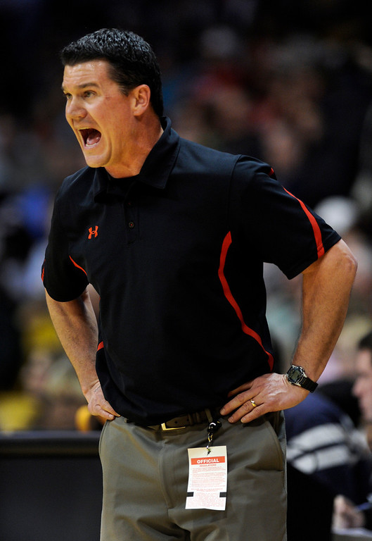 . BOULDER, CO. - MARCH 16: Raptors coach John Olander had to yell to be hear in the second half. The Eaglecrest High School boy\'s basketball beat Denver East 63-44 in the 5A championship game Saturday, March 16, 2013 at the Coors Events Center in Boulder.  (Photo By Karl Gehring/The Denver Post)