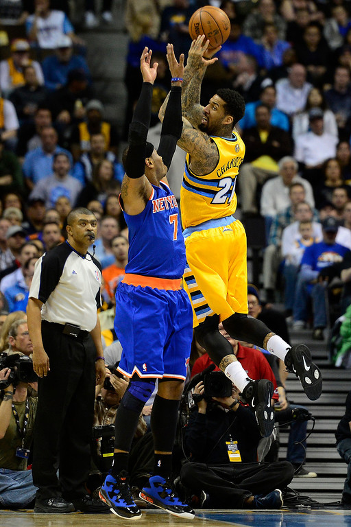 . DENVER, CO - MARCH 13: Carmelo Anthony (7) of the New York Knicks defends Wilson Chandler (21) of the Denver Nuggets during the first half of action. The Denver Nuggets play the New York Knicks at the Pepsi Center. (Photo by AAron Ontiveroz/The Denver Post)