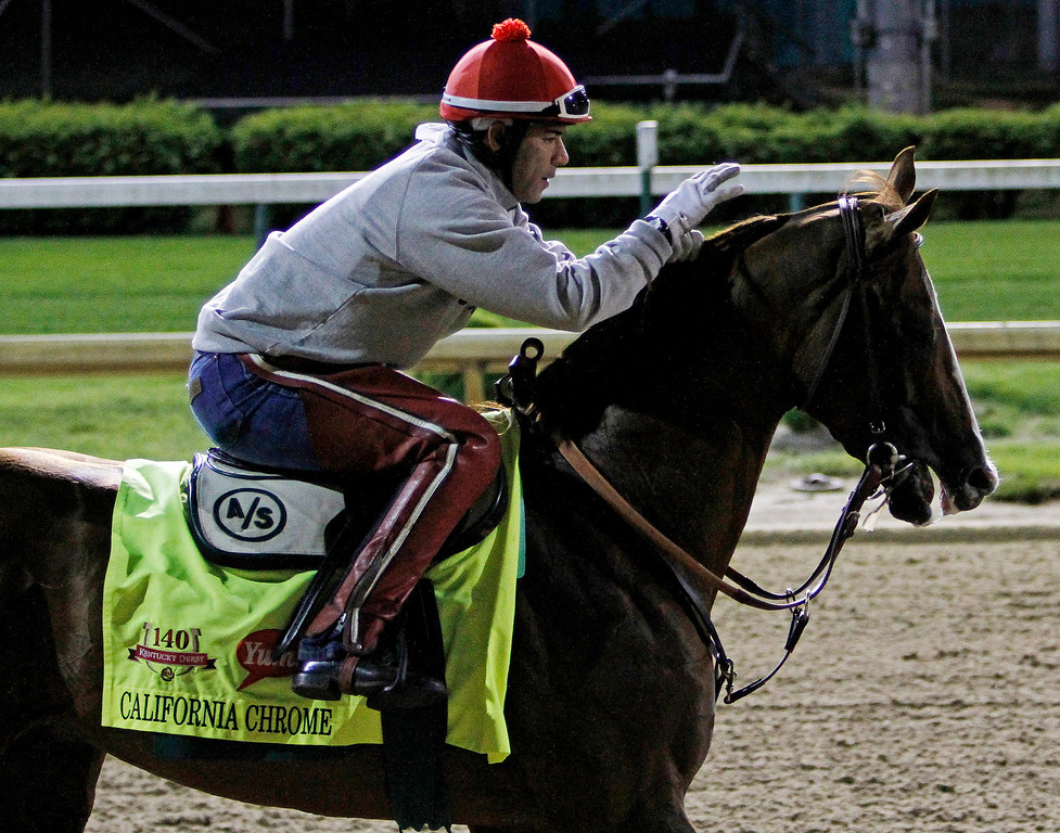 . Exercise rider William Delgado takes Kentucky Derby entrant California Chrome for a morning workout at Churchill Downs Friday, May 2, 2014, in Louisville, Ky. (AP Photo/Garry Jones)