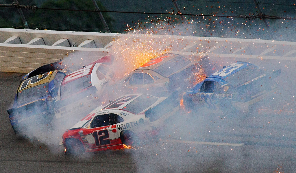 . Brian Scott (2) crashes with Johanna Long (70), Trevor Bayne (6), Ty Dilon (33) and Sam Hornish Jr. (12) in Turn 3 during the NASCAR Nationwide Series auto race at the Talladega Superspeedway in Talladega, Ala., Saturday, May 4, 2013. (AP Photo/Greg McWilliams)