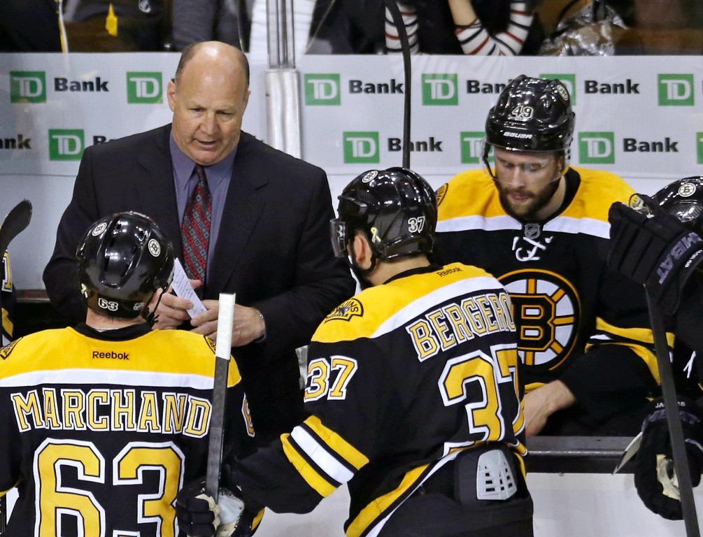 . Boston Bruins coach Claude Julien talks with his players during a timeout in the third period against the Pittsburgh Penguins during Game 3 of the NHL hockey Stanley Cup playoffs Eastern Conference finals, in Boston on Wednesday, June 5, 2013. (AP Photo/Charles Krupa)