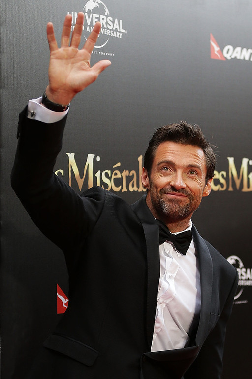 . Hugh Jackman waves to fans during the Australian premiere of \'Les Miserables\' at the State Theatre on December 21, 2012 in Sydney, Australia.  (Photo by Brendon Thorne/Getty Images)