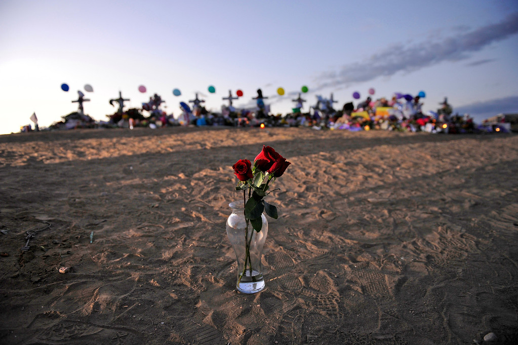 . The sun rises, Thursday, July 26, 2012, over the memorial for shooting victims near the Century Aurora 16 Multiplex. RJ Sangosti, The Denver Post