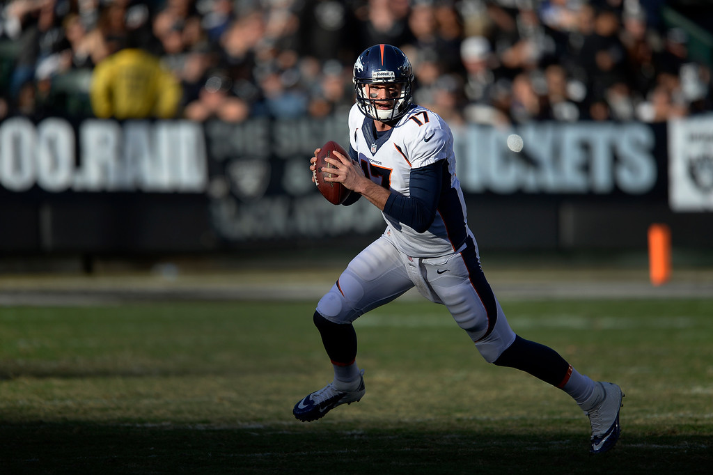 . Denver Broncos quarterback Brock Osweiler (17) scrambles out of the pocket during the third quarter against the Oakland Raiders at O.co Coliseum. (Photo by John Leyba/The Denver Post)