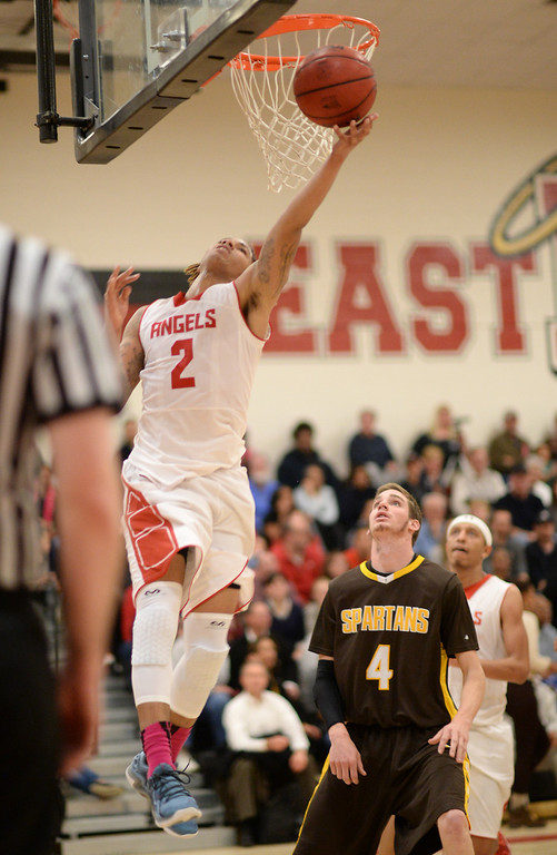 . DENVER, CO. JANUARY 24: Jevon Griffin of East High School (2) makes a basket during 2nd half of the game against Thomas Jefferson High School at East High School in Denver, Colorado January 24, 2014. East High School won 91-62. (Photo by Hyoung Chang/The Denver Post)
