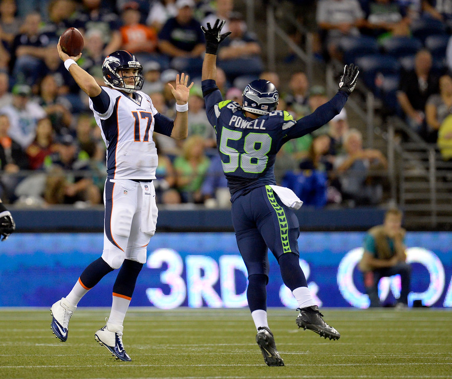 . SEATTLE, WA. - AUGUST 17: Denver Broncos quarterback Brock Osweiler (17) throws a pass over Seattle Seahawks linebacker Ty Powell (58) during the fourth quarter August 17, 2013 at Century Link Field. (Photo By John Leyba/The Denver Post)