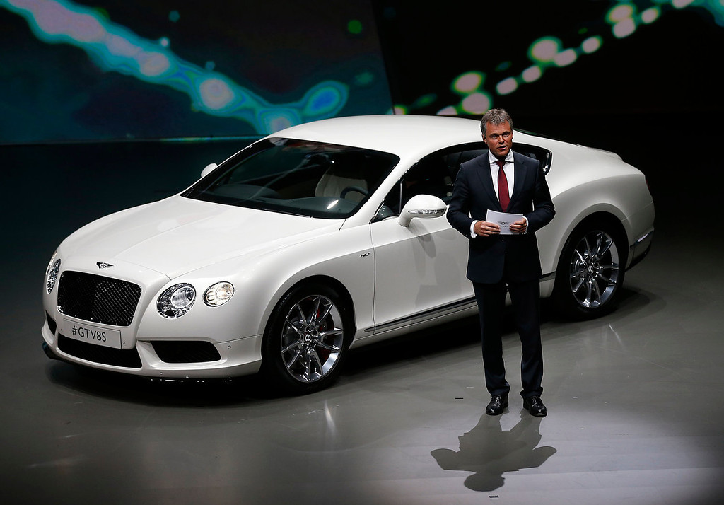 . Wolfgang Schreiber, CEO of Bentley Motors, presents the new Bentley GT V8S during a preview by the Volkswagen Group prior to the 65th Frankfurt Auto Show in Frankfurt, Germany, Monday, Sept. 9, 2013. More than 1,000 exhibitors will show their products to the public from Sept. 12 through Sept. 22, 2013. (AP Photo/Frank Augstein)
