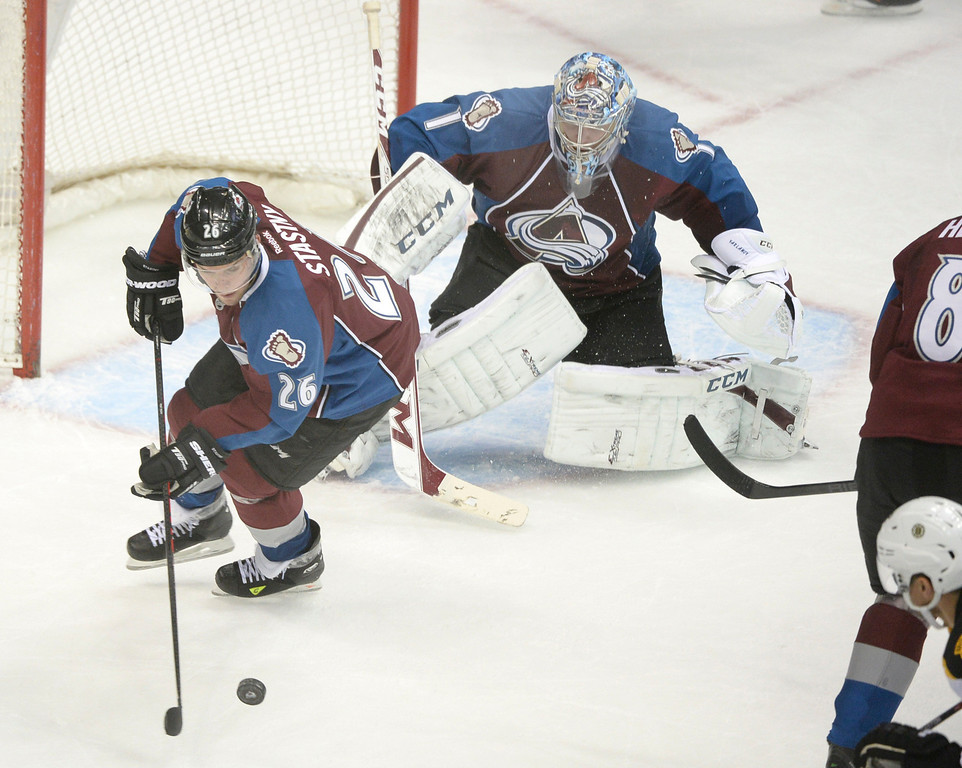 . Colorado center Paul Stastny (26) cleared the puck away from goaltender Semyon Varlamov in the second period. The Colorado Avalanche hosted the Boston Bruins at the Pepsi Center Friday night, March 21, 2014. (Photo by Karl Gehring/The Denver Post)