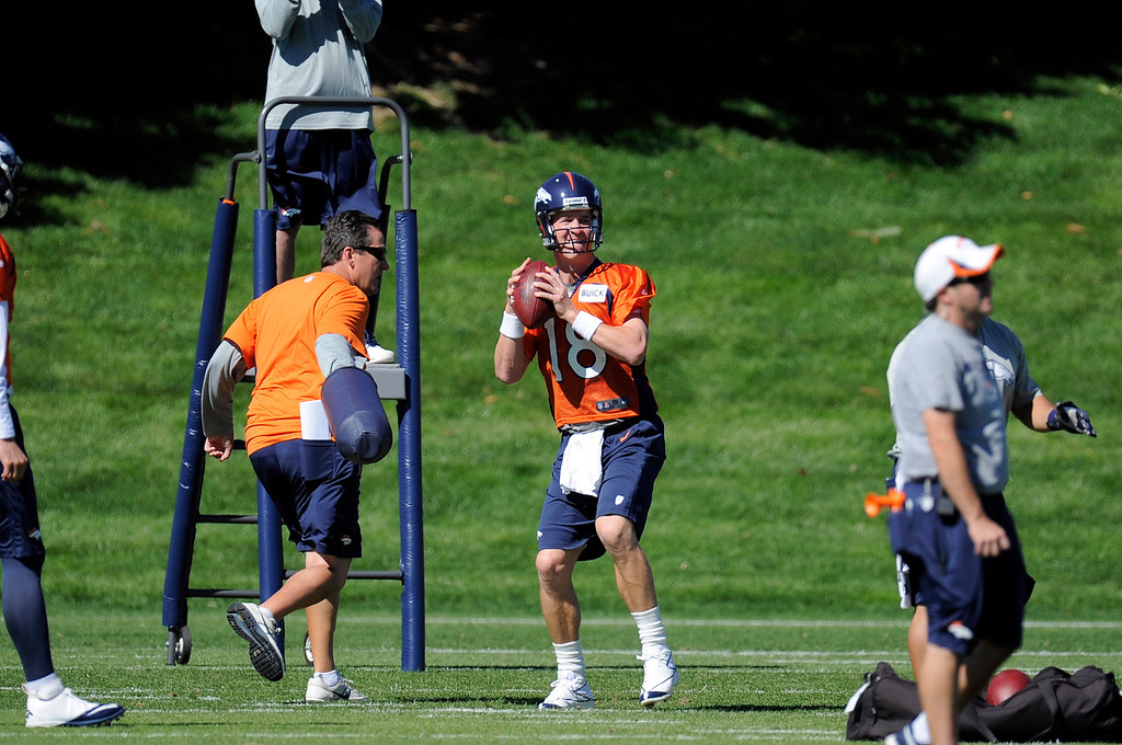 . Quarterback Peyton Manning (18) of the Denver Broncos drops back to pass during practice September 25, 2013 at Dove Valley. (Photo by John Leyba/The Denver Post)