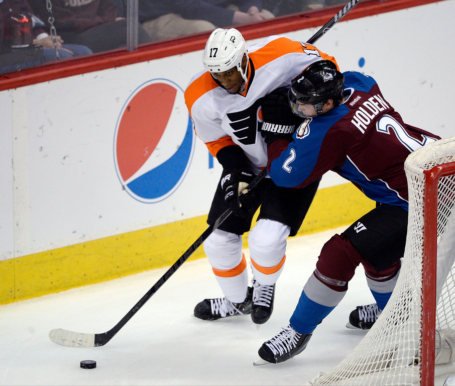 . Colorado Avalanche defenseman Nick Holden (2) battles for the puck with Philadelphia Flyers right wing Wayne Simmonds (17) during the second period January 2, 2014 at Pepsi Center. (Photo by John Leyba/The Denver Post)