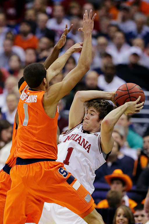 . Indiana guard Jordan Hulls (1) looks for an opening to pass under pressure from Syracuse guard Michael Carter-Williams (1) during the first half of an East Regional semifinal in the NCAA college basketball tournament, Thursday, March 28, 2013, in Washington. (AP Photo/Alex Brandon)