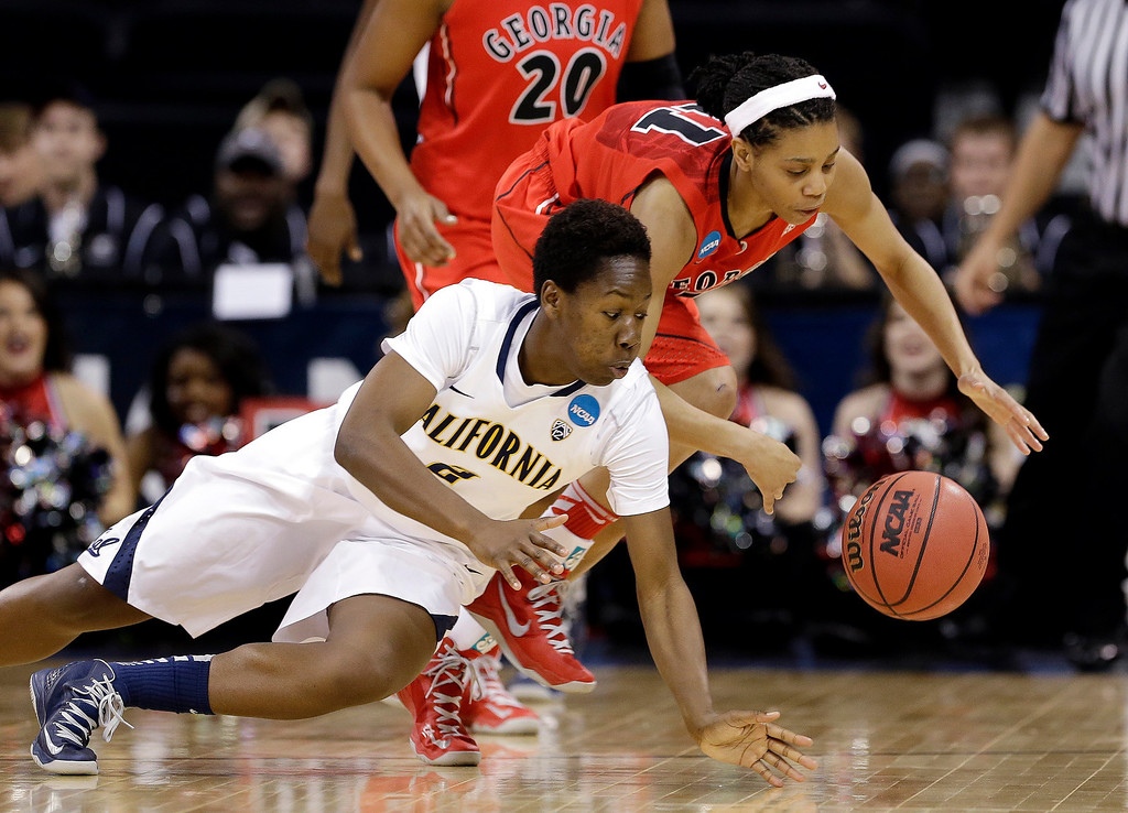 . California\'s Afure Jemerigbe, left, and Georgia\'s Tiaria Griffin dive for a loose ball during the first half in a regional final in the NCAA women\'s college basketball tournament, Monday, April 1, 2013, in Spokane, Wash. (AP Photo/Elaine Thompson)