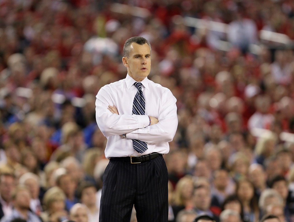 . Florida head coach Billy Donovan looks on during the second half of an NCAA Final Four tournament college basketball semifinal game against Connecticut Saturday, April 5, 2014, in Arlington, Texas. Connecticut won 63-53. (AP Photo/Charlie Neibergall)