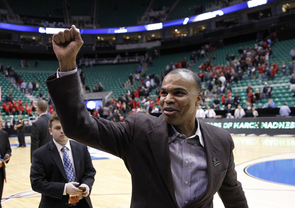 . Harvard head coachTommy Amaker celebrates after his team defeated New Mexico New Mexico 68-62 during a second-round game in the NCAA college basketball tournament in Salt Lake City Thursday, March 21, 2013. (AP Photo/Rick Bowmer)