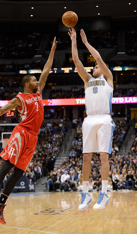 . DENVER, CO. - JANUARY 30: Denver Nuggets small forward Danilo Gallinari (8) shoots a three point shot over Houston Rockets power forward Marcus Morris (2) during the second quarter quarter January 30, 2013 at Pepsi Center.  The Denver Nuggets take on the Houston Rockets in NBA action. (Photo By John Leyba/The Denver Post)