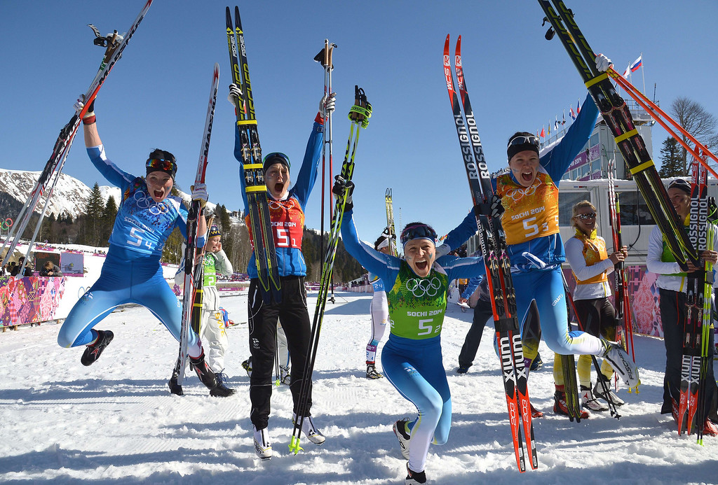 . (L-R) Finland\'s Krista Lahteenmaki,  Anne Kylloenen, Aino-Kaisa Saarinen, Kerttu Niskanen celebrate their Silver Medal in the Women\'s Cross-Country Skiing 4x5km Relay at the Laura Cross-Country Ski and Biathlon Center during the Sochi Winter Olympics on February 15, 2014, in Rosa Khutor, near Sochi.    ALBERTO PIZZOLI/AFP/Getty Images