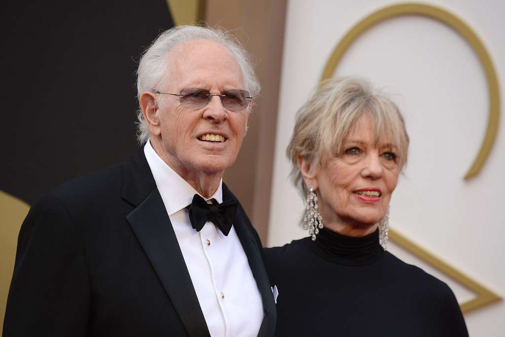 . Bruce Dern, left, and Andrea Beckett arrive at the Oscars on Sunday, March 2, 2014, at the Dolby Theatre in Los Angeles.  (Photo by Jordan Strauss/Invision/AP)