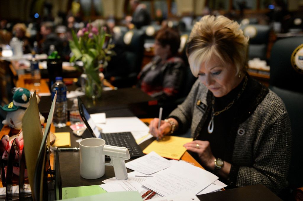 . DENVER, CO. - FEBRUARY 15: Representative Amy Stephens and her pistol cup she got weeks ago from Urban Outfitters, working on notes before giving argument against HB 1224 prohibiting large capacity ammunition magazines in the Colorado House at the Denver State Capitol February 15, 2013. Denver, Colorado. (Photo By Joe Amon/The Denver Post)