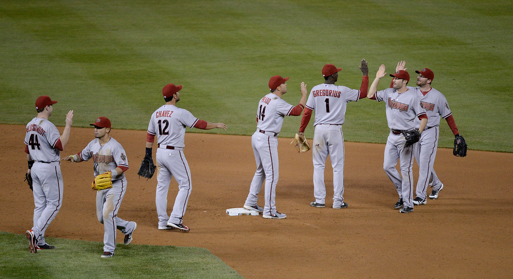 . DENVER, CO. - MAY 20: The Arizona Diamondbacks congratulate one in other after winning their game against the Colorado Rockies 5-1 May 20, 2013 at Coors Field. (Photo By John Leyba/The Denver Post)