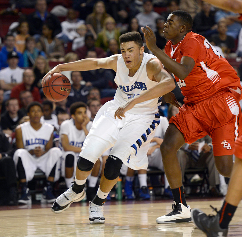 . DENVER, CO. - FEBRUARY 09: Zach Braxton (34) of Highlands Ranch drives on Triston Terroade (22) of East February 9, 2012 at Magness Arena.  East defeated Highlands Ranch 73 - 54. (Photo By John Leyba/The Denver Post)