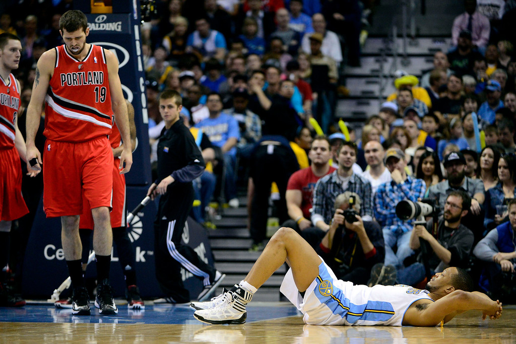 . DENVER, CO - APRIL 14: Anthony Randolph (15) of the Denver Nuggets lays on the floor after making contact with Joel Freeland (19) of the Portland Trail Blazers during the second half of action. The Denver Nuggets defeat the Portland Trail Blazers 118-109 at the Pepsi Center. (Photo by AAron Ontiveroz/The Denver Post)