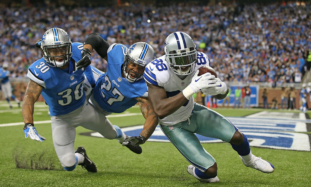 . Dez Bryant #88 of the Dallas Cowboys scores on a five yard touchdown pass from Tony Romo #9 during the second quarter ofd the game at Ford Field on October 27, 2013 in Detroit, Michigan.  (Photo by Leon Halip/Getty Images)