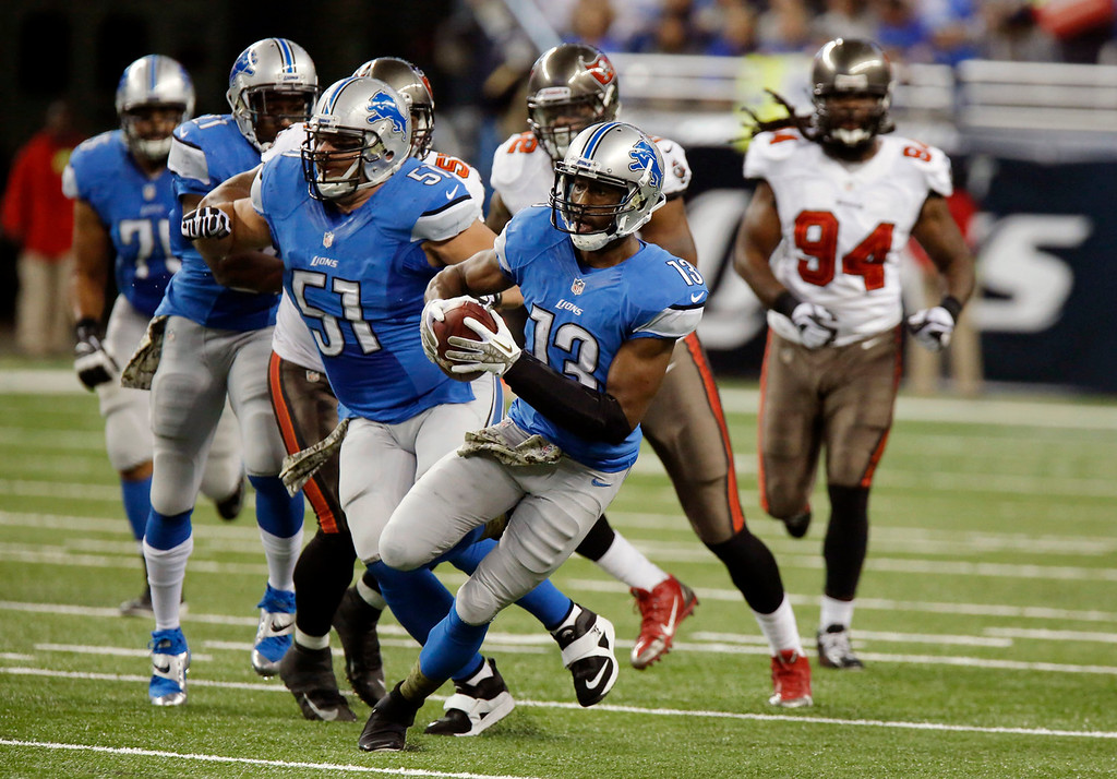 . Detroit Lions wide receiver Nate Burleson (13)  runs for a 28-yard reception during the first quarter of an NFL football game against the Tampa Bay Buccaneers in Detroit, Sunday, Nov. 24, 2013. (AP Photo/Duane Burleson)