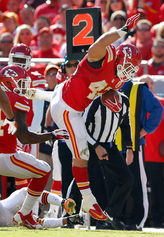 . Kansas City Chiefs fullback Anthony Sherman (42) avoids a tackle on a touchdown run during the first half of an NFL football game against the Cleveland Browns in Kansas City, Mo., Sunday, Oct. 27, 2013. (AP Photo/Ed Zurga)