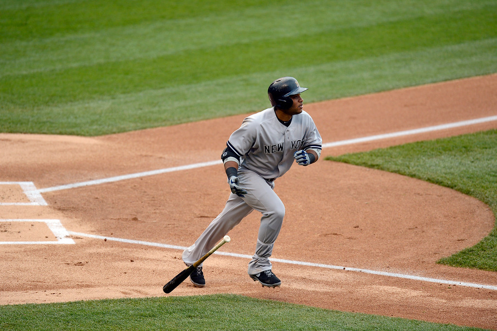 . Robinson Cano (24) of the New York Yankees watches his hit sail over the wall for a home run in the fifth inning off of Adam Ottavino (0) of the Colorado Rockies May 9, 2013 at Coors Field. (Photo By John Leyba/The Denver Post)