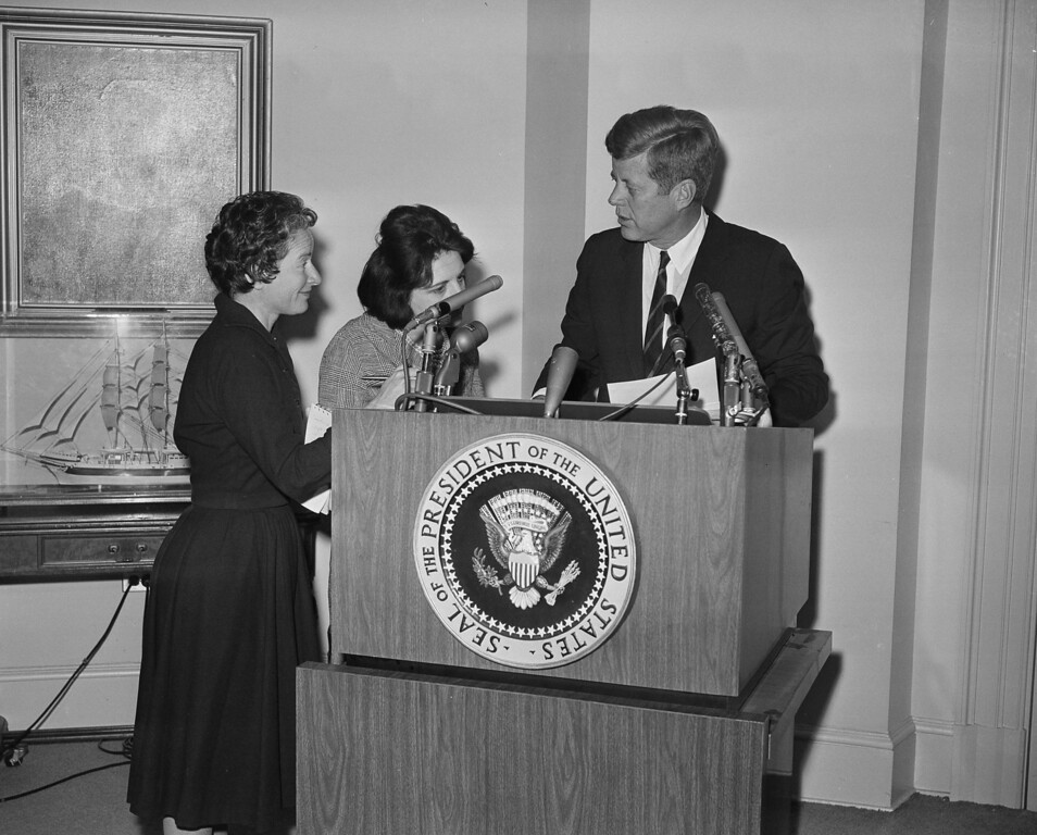 . Frances Lewine, left, of The Associated Press, and another reporter, Helen Thomas, ask President Kennedy for copies of his announcement pledging Federal power to preserve order and lives in Birmingham, Ala. The Chief Executive, speaking from the White House on May 12, 1963, ordered alerting of military force and preliminary steps to call out the Alabama National Guard following the outbreak of racial rioting in the Alabama city. (AP Photo/Bill Allen)