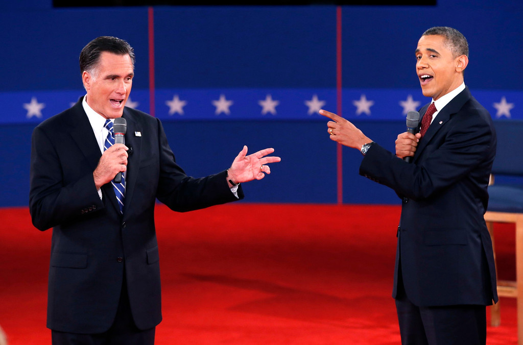 . U.S. Republican presidential nominee Mitt Romney (L) and U.S. President Barack Obama speak directly to each other during the second U.S. presidential debate in Hempstead, New York, October 16, 2012.  REUTERS/Mike Segar