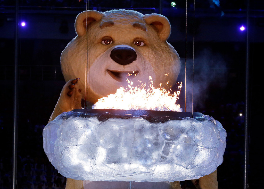 . A large mascot blows out the Olympic flame with his breath during the closing ceremony of the 2014 Winter Olympics, Sunday, Feb. 23, 2014, in Sochi, Russia. (AP Photo/Charlie Riedel)