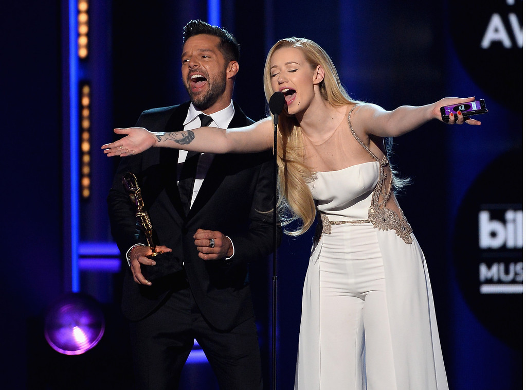 . Singers Ricky Martin (L) and Iggy Azalea speak onstage during the 2014 Billboard Music Awards at the MGM Grand Garden Arena on May 18, 2014 in Las Vegas, Nevada.  (Photo by Ethan Miller/Getty Images)