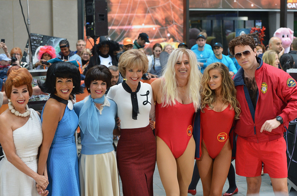 """. (L-R) Kathie Lee Gifford, Hoda Kotb, Natalie Morales, Savannah Guthrie, Matt Lauer, Carmen Electra and Willie Geist attend NBC\'s \""""Today\"""" Halloween 2013 in Rockefeller Plaza on October 31, 2013 in New York City.  (Photo by Slaven Vlasic/Getty Images)"""