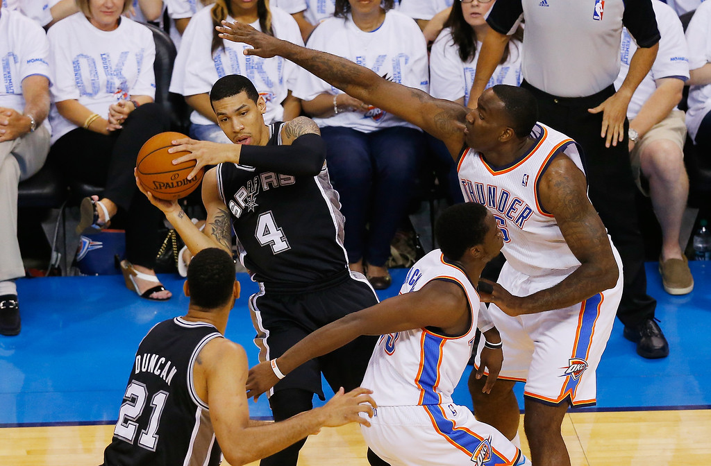 . OKLAHOMA CITY, OK - MAY 31:  Danny Green #4 of the San Antonio Spurs battles for the ball against Kendrick Perkins #5 of the Oklahoma City Thunder in the first half during Game Six of the Western Conference Finals of the 2014 NBA Playoffs at Chesapeake Energy Arena on May 31, 2014 in Oklahoma City, Oklahoma. (Photo by Tom Pennington/Getty Images)